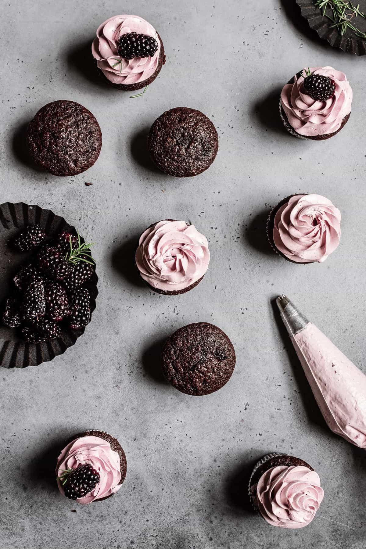 Easy Chocolate Rosemary cupcakes with blackberry buttercream.
