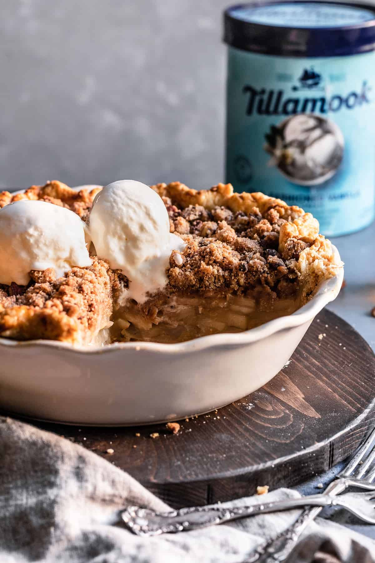 Pear pie with pecan cinnamon streusel topped with Tillamook ice cream.